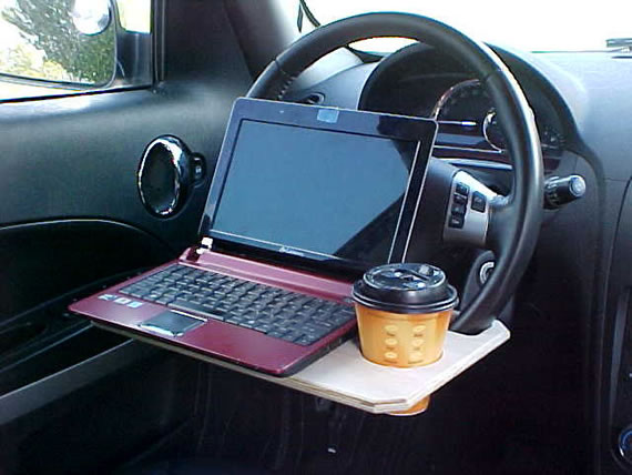 Steering Wheel table functions as your dining table/Laptop/iPad stand
