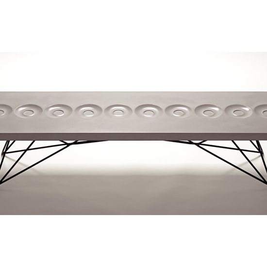 Orson Coffee Table by Brandon Gore comes with built-in saucers
