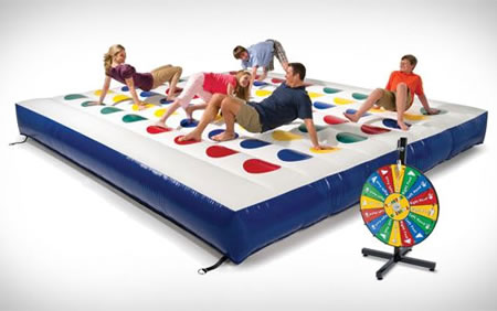 Let's play a game on the Massive Outdoor Inflatable Twister Game