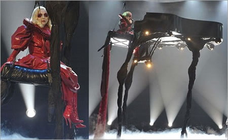 Lady Gaga swings in the air atop a 20 foot tall piano