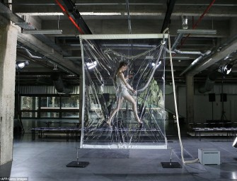 Iris Van Herpen Presents Vacuum-Packed Models for Fall 2014 Show