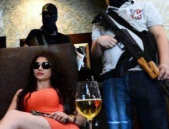 Kim Kardarshain doppelgänger runs the Mexico Drug Cartel with her customized Pink AK-47