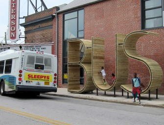 The BUS Bus Stop in Baltimore lets you take shade under giant typographic sculptures