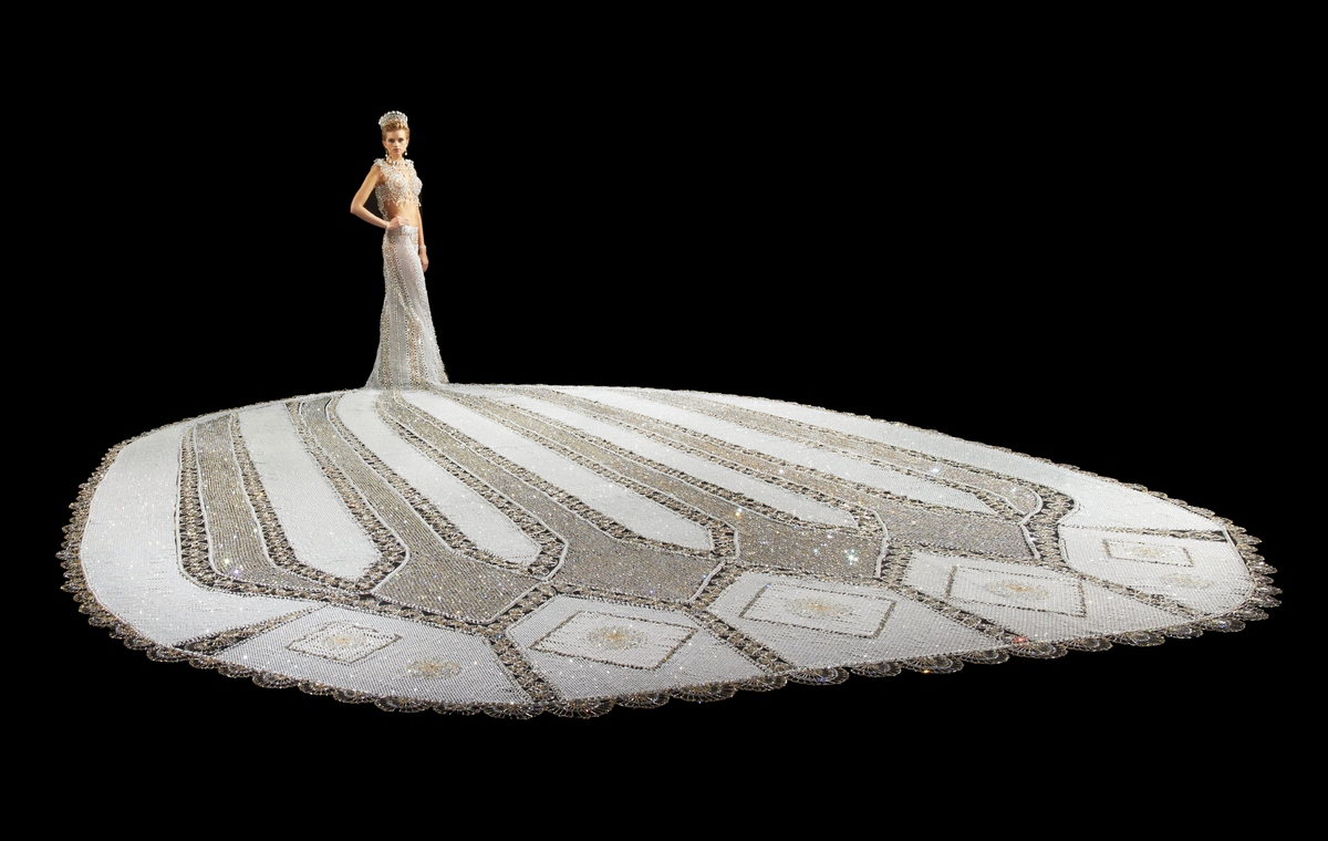World's heaviest Wedding Dress is filled with crystals and pearls