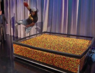 Marshawn Lynch Dives Backwards into an end-zone of Skittles on Conan